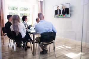 Video Conference of business people listening to the CEO.