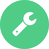 White wrench in a green circle background.